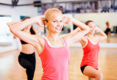 Group of smiling people exercising in the gym Royalty Free Stock Photo