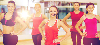 Group of smiling people exercising in the gym royalty free stock photos