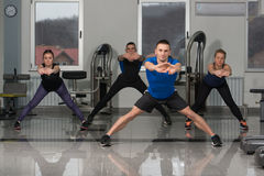 Group Of Smiling People Exercising In The Gym Stock Photos