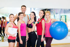 Group of smiling people in the gym Royalty Free Stock Images