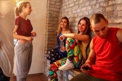 Smiling people having a break at dances in studio royalty free stock images