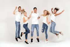 Group of smiling people jumping,having fun together. stock photo
