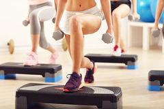 Group of smiling people lifting barbells. Group of happy women doing aerobics Stock Images