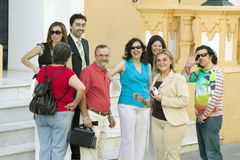 Group of smiling people near front of church in village of Southern Spain off highway A49 west of Sevilla Stock Photography