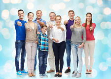 Group of smiling people pointing finger on you Royalty Free Stock Photo