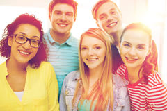 Group of smiling people at school or home Royalty Free Stock Images