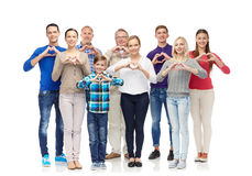 Group of smiling people showing heart hand sign Royalty Free Stock Photo