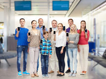 Group of smiling people with smartphones Stock Image