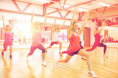 Group of smiling people stretching in the gym Royalty Free Stock Image