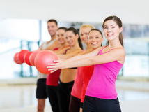Group of smiling people working out with ball Stock Photo