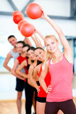 Group of smiling people working out with ball Royalty Free Stock Image