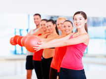 Group of smiling people working out with ball Stock Photography