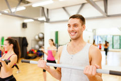 Group of smiling people working out with barbells Stock Photography