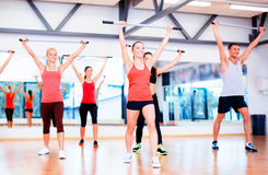 Group of smiling people working out with barbells Royalty Free Stock Images