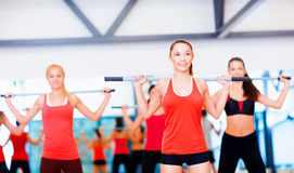 Group of smiling people working out with barbells Royalty Free Stock Photo