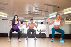 Group of smiling people working out with barbells Royalty Free Stock Photography