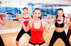 Group of smiling people working out with barbells Stock Images