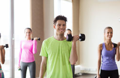Group of smiling people working out with dumbbells Stock Photos