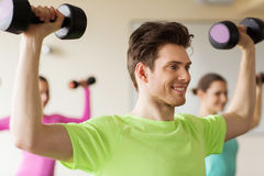 Group of smiling people working out with dumbbells Royalty Free Stock Image