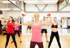 Group of smiling people working out with dumbbells Royalty Free Stock Images