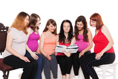 Group of smiling pregnant women sitting and Stock Photos