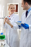 Group of smiling scientist analyzing molecular structure Stock Photos
