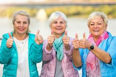 Senior women showing thumbs up Stock Images