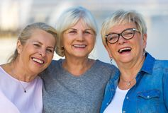 Group of senior women smiling. Group of smiling senior women standing outside Royalty Free Stock Photography