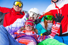 Group of smiling snowboarders having fun Stock Photos