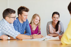 Group of smiling students with blueprint Royalty Free Stock Image