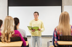 Group of smiling students in classroom Royalty Free Stock Photo