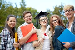 Group of smiling students with diploma and folders Stock Image