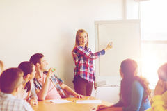 Group of smiling students with flip board Royalty Free Stock Images