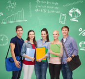 Group of smiling students with folders and bags Royalty Free Stock Image