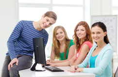 Group of smiling students having discussion Stock Photos