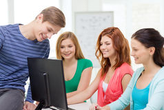 Group of smiling students having discussion Stock Image