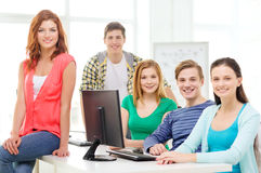 Group of smiling students having discussion Royalty Free Stock Images