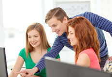 Group of smiling students having discussion Stock Images