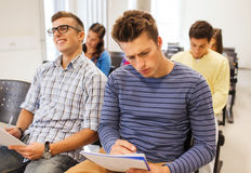 Group of smiling students in lecture hall Stock Photos