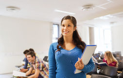 Group of smiling students in lecture hall Royalty Free Stock Image