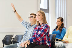 Group of smiling students in lecture hall Stock Photography