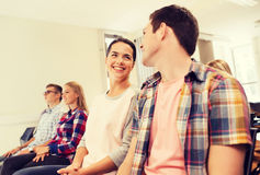 Group of smiling students in lecture hall Stock Photo