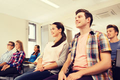 Group of smiling students in lecture hall. Education, high school, teamwork and people concept - group of smiling students sitting in lecture hall Stock Photo