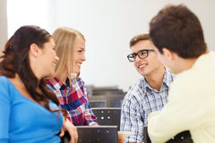 Group of smiling students in lecture hall Royalty Free Stock Photo