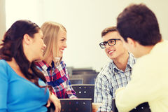 Group of smiling students in lecture hall Royalty Free Stock Photos