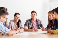 Group of smiling students meeting at school royalty free stock photography