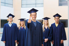 Group of smiling students in mortarboards Stock Images
