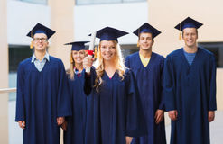 Group of smiling students in mortarboards Stock Photography