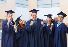 Group of smiling students in mortarboards Stock Photo