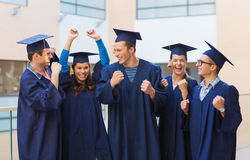 Group of smiling students in mortarboards Royalty Free Stock Photo